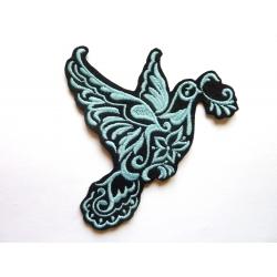 Ecusson colombe en vol bleue