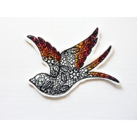 Ecusson silhouette oiseau décorée de fleurs