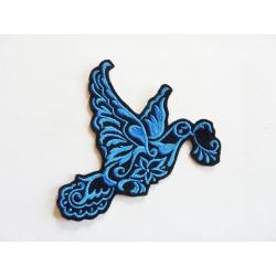 Colombe bleue moyen en vol