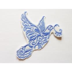 Oiseau, Colombe bleue en vol