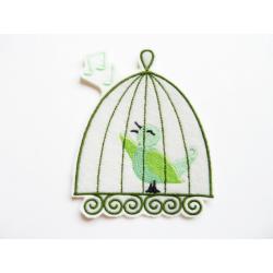 Patch thermocollant oiseau vert dan une cage